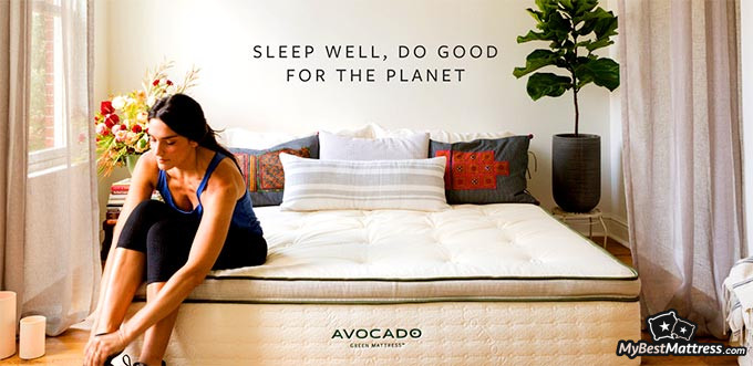 Avocado mattress reviews: woman sitting on the mattress.