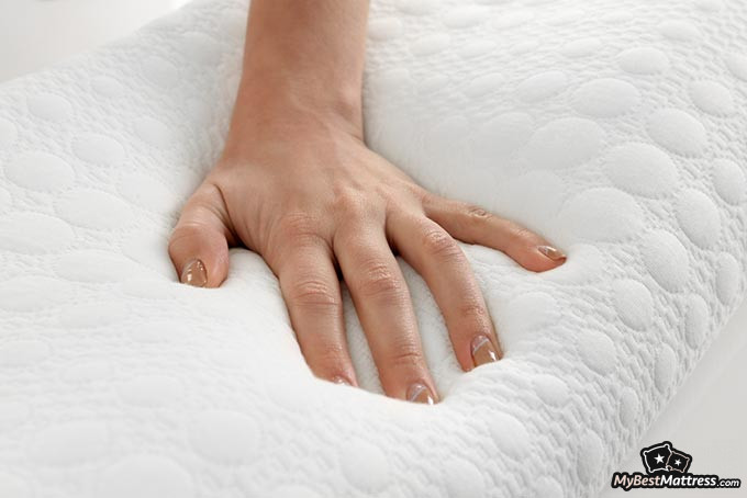 Best memory foam pillow: a woman's hand on a memory foam pillow.
