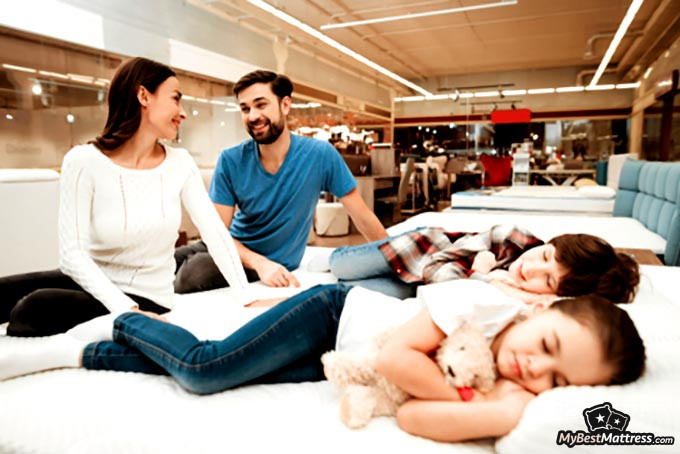 Best place to buy a mattress: kids lying on a bed.