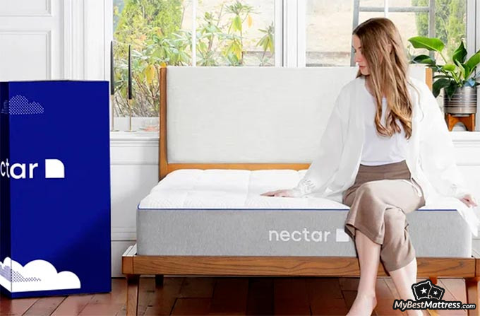 Nectar VS Casper: the Nectar mattress and a girl sitting on it.