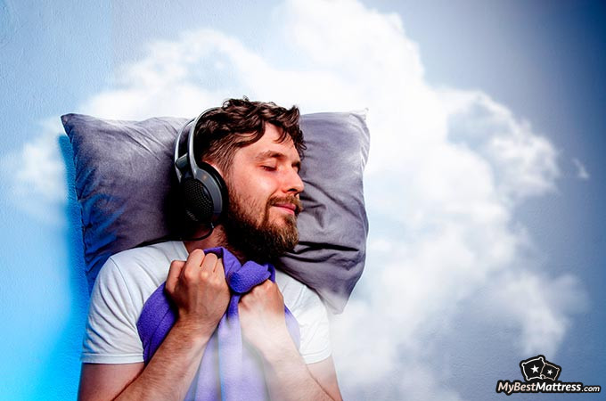 Noise-canceling headphones for sleeping: a man sleeping with headphones on.
