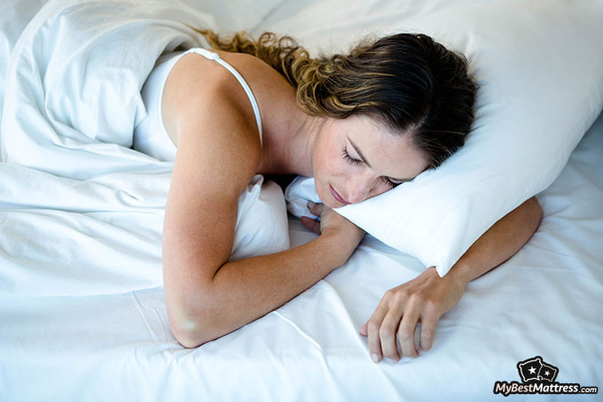 Best pillow: woman sleeping with pillow.